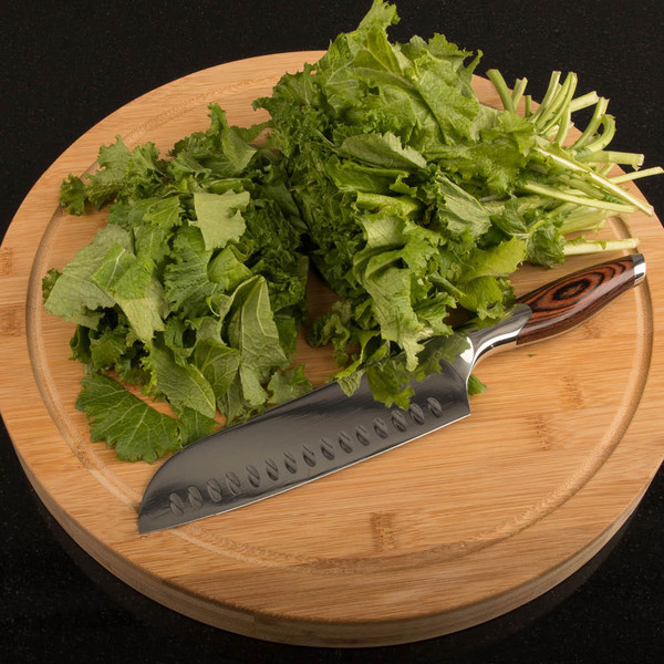 Bamboo cutting board with lettuce